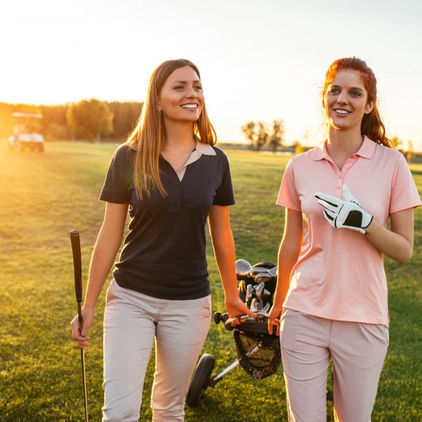 Two women walking on the golf coarse